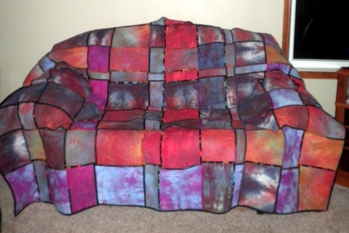 The woven quilt as a slip cover on my couch