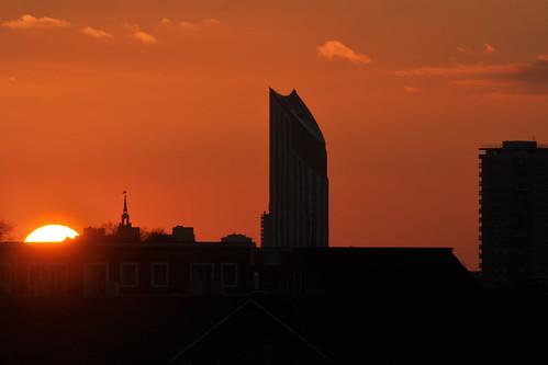 Sun sets behind Strata