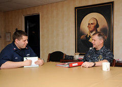 YOKOSUKA, Japan (March 07, 2012) Capt. John Jones, the Navy's leading community manager for the Chief Warrant Officer/Limited Duty Officer program at the Bureau of Naval Personnel, reviews a Sailor's commissioning package during a visit aboard the aircraft carrier USS George Washington (CVN 73). (U.S. Navy photo by Mass Communication Specialist Seaman Apprentice Brian H. Abel)