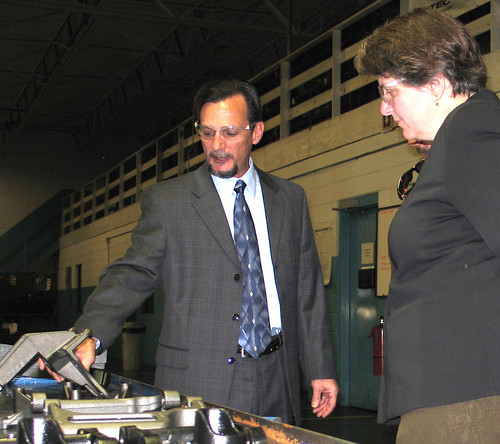 Photo Caption:  Aztec Manufacturing President/CEO Greg Lopez speaks with Agriculture Deputy Secretary Kathleen Merrigan.