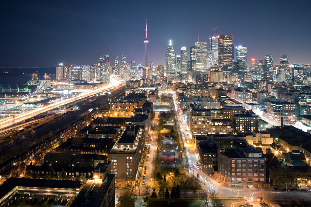 rooftopping image of downtown toronto skyline at night