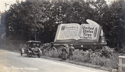 "Two miles outside Rhinebeck, New York, USA. 1920s. ""United States Tires are Good Tires"" billboard"