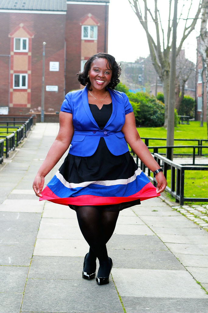 multi-coloured-skater-dress-with-blue-blazer-stocking-and-black-stilettos-heels,multi coloured skater dress, skater dress for curvy women, short sleeved blazer, short sleeved blue blazer, womens short sleeved blazer, womens short sleeved  blue blazer, how to style a blue structured jacket, how to style a blue structured jacket with a dress, blue jacket, small blue jacket, blue jacket for women,  fit and flared dress, Multi coloured fit & flare dress with a blue short sleeved blazer