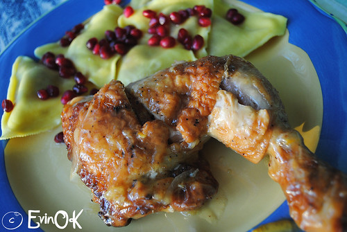 Orange Roast Chicken with Butternut Squash Ravioli and Pomegranate Seeds