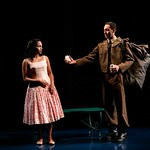 Flora (played by Monica Raymund) meets Eusebio (played by Elliot Villar), a handsome National Guard soldier in the Huntington Theatre Company's production of <i>Boleros for the Disenchanted</i> by José Rivera at the South End/Calderwood Pavilion at the BCA. Part of the 2008-2009 season. Photo: T. Charles Erickson