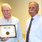 Ted Smith (left) was honored with the state's 2012 Extra Mile Award. It was presented June 11 by Commissioner of Public Lands Peter Goldmark (right). Smith was honored for his dedication to helping customers of the Public Lands Survey Office at DNR.