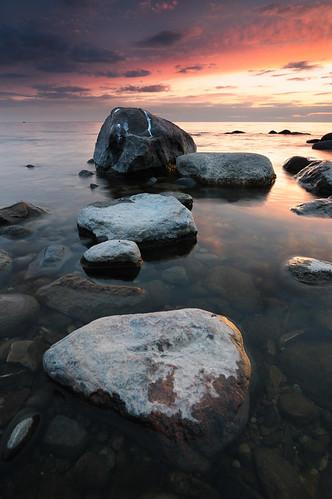 sunset sea sky evening nikon rocks gulf stones eu baltic latvia tokina filter benson dary riga holder cokin latvija 1116 singhray colorphotoaward skulte d300s 116pro blinkagain
