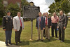 Major Stewart Robbins, assistant professor of military science, Board of Trustees member Jimmy Rane, Interim Provost Timothy Boosinger and members of the Morris, Nelson, Perritt and Kelly families with the historic marker.