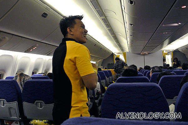 Friendly and jovial Scoot air steward serving us