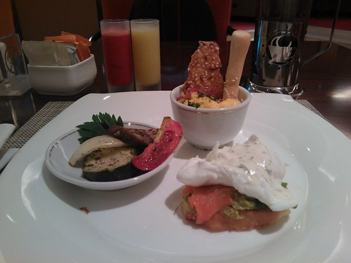 Clockwise from front: Smoked Salmon and Poached Egg, Grilled Vegetables, Eye Opener Shots, and Scrambled Eggs with Tomato Salsa