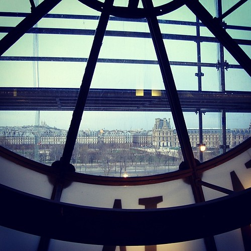 Remembering Paris: one of my rare personal photo treasures -- taken many years ago with a shot from one of the clocks within the Musee D'Orsay showing the Louvre across the Seine.  One day I'll take that third trip to Paris yet and maybe take a better sho