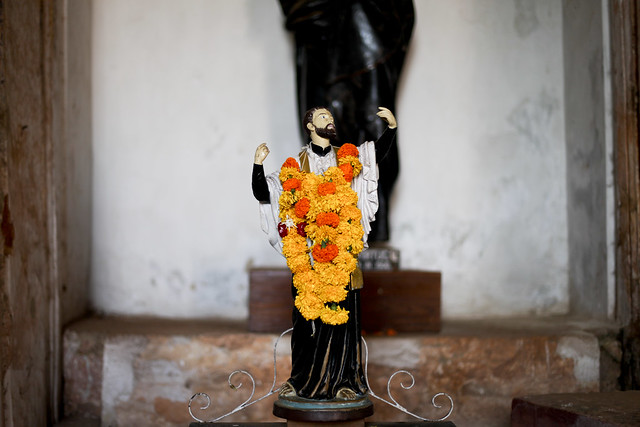 Statue over garlanded