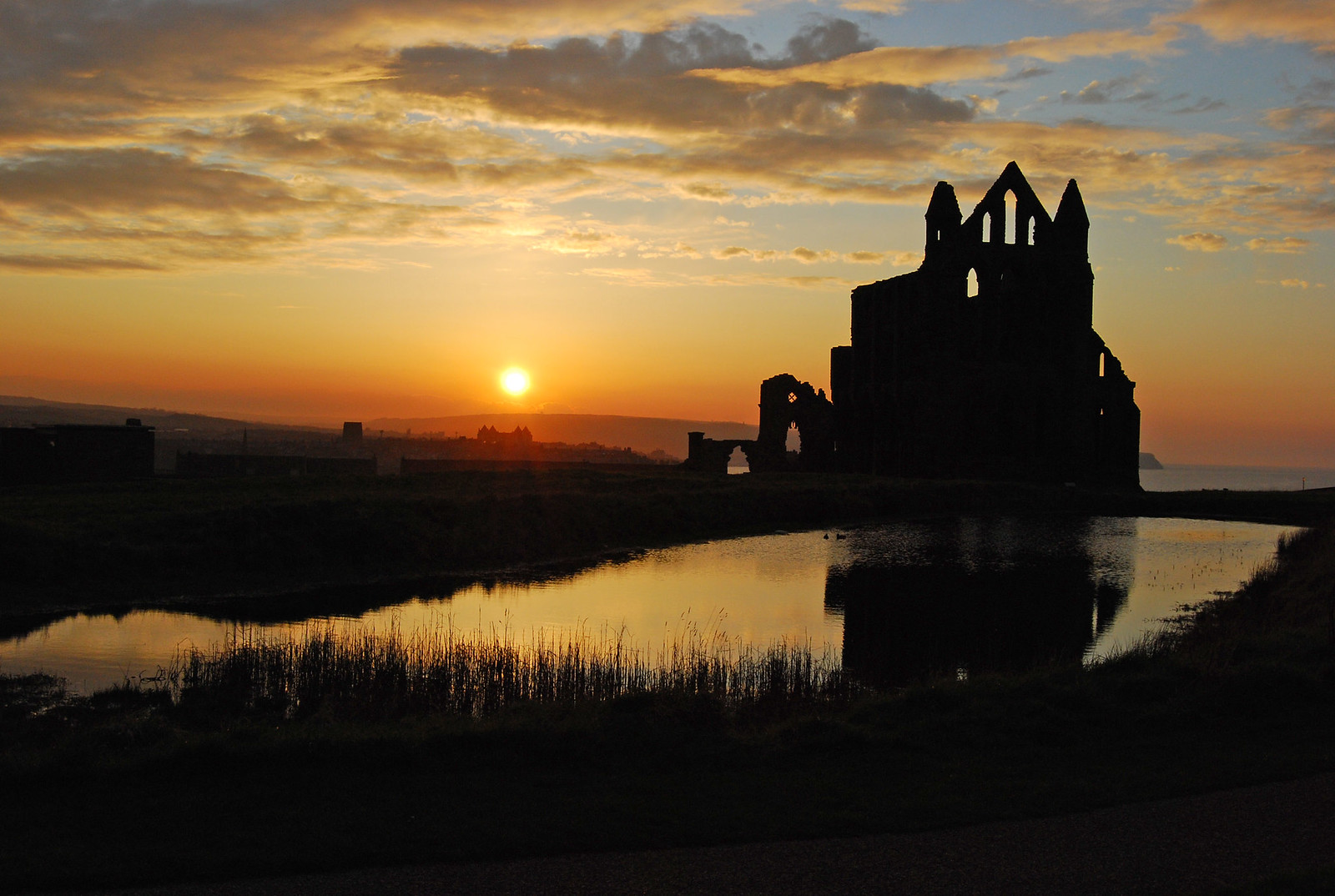Whitby Abbey at sunset with reflections. Credit Ackers72