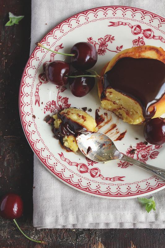 Quark pancakes (syrniki) with sweet cherry and chocolate