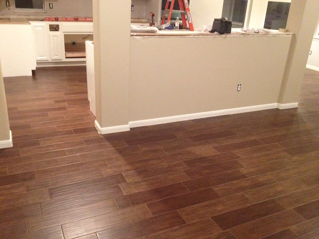 We just finished the install of our porcelain plank wood tiles. We love em,  and think they turned out great. - Porcelain Tiles That Look Like Wood