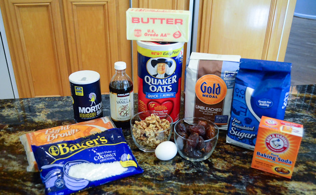 All the ingredients required to make Oatmeal Coconut Date Cookies on a counter top.
