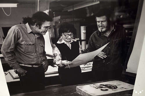 Lois Long and John Cage inspect a print with the publisher.