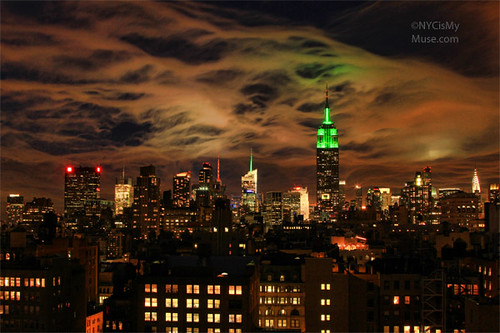 Amazing ethereal skyline clouds: Empire State Building in green for Earth Day