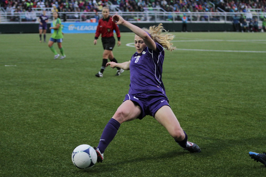 a soccer player goes for the ball