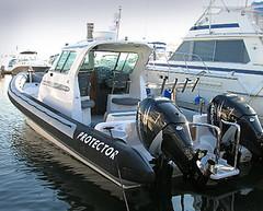 skiff(0.0), bass boat(0.0), vehicle(1.0), boating(1.0), motorboat(1.0), inflatable boat(1.0), rigid-hulled inflatable boat(1.0), watercraft(1.0), boat(1.0),