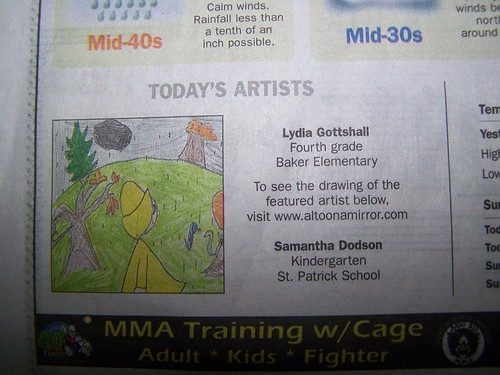 L in the newspaper by Emilyannamarie