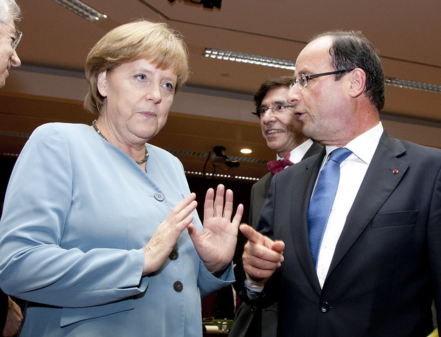 François Hollande, the new French President, talks to German Chancellor Angela Merkel, Brussels, 23 May 2012