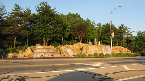 The picturesque man made waterfall at Higgns Avenue and River Road.  Rosemont Illinois. May 2012. by Eddie from Chicago