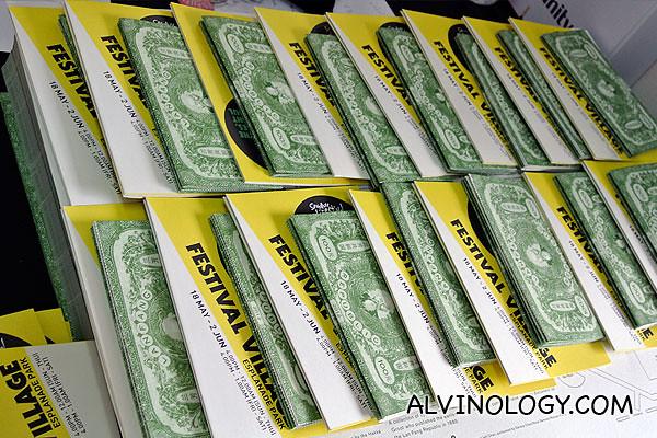 Program booklets shaped like Lan Fang currencies