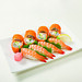 Imitation crab, sliced avocado and cucumber, topped with masago roe along with shrimp nigiri.