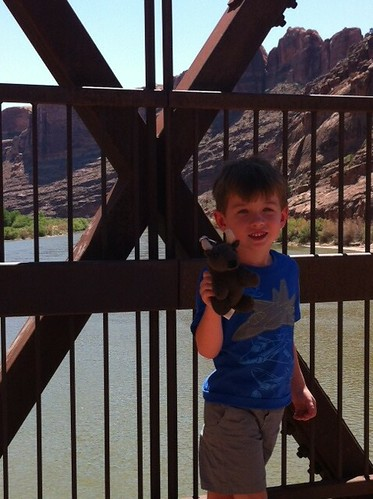 Chase and Buddy on the bridge over the Colorado River in Moab, Utah.