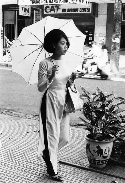 It's not all bloodshed (2/10) - Armed with an umbrella to protect her against the sun, a Saigon housewife goes shopping.