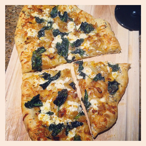 Dinner last night: Homemade Caramelized Onion, Spinach and Goat Cheese pizza. So delicious!
