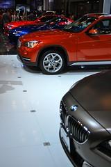 automobile, automotive exterior, exhibition, wheel, vehicle, automotive design, bmw x1, auto show, crossover suv, bumper, land vehicle, luxury vehicle, sports car, motor vehicle,