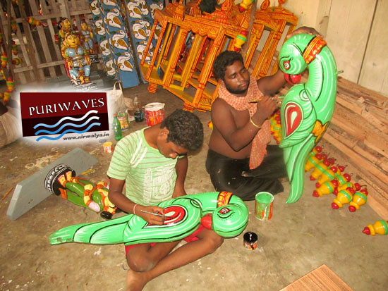 Chitrakar (artist) is Painting the parts of Chariots Rathyatra
