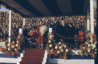 Princess Elizabeth holding flowers on stage with Prince Philip and other unidentified men  / La princesse Elizabeth tenant des fleurs sur une estrade avec prince Philip et plusieurs hommes