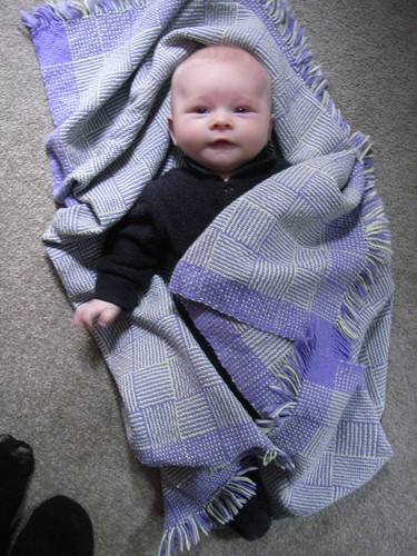 Alistair wrapped in woven blanket