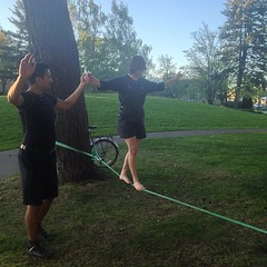 Leo teaching Angel to slack line for the first time.