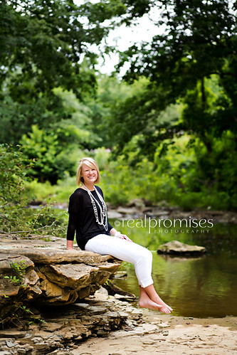 senior girl in creek for pictures