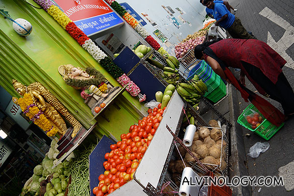A lady buying vegetable