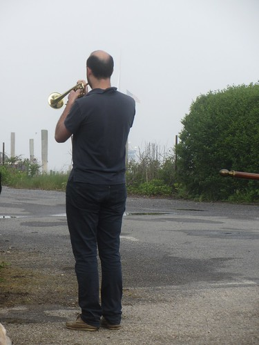 playing taps by the water for those lost at sea