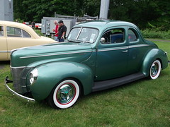 1937 ford(0.0), mid-size car(0.0), automobile(1.0), automotive exterior(1.0), 1941 ford(1.0), wheel(1.0), vehicle(1.0), custom car(1.0), compact car(1.0), hot rod(1.0), antique car(1.0), sedan(1.0), land vehicle(1.0), motor vehicle(1.0),