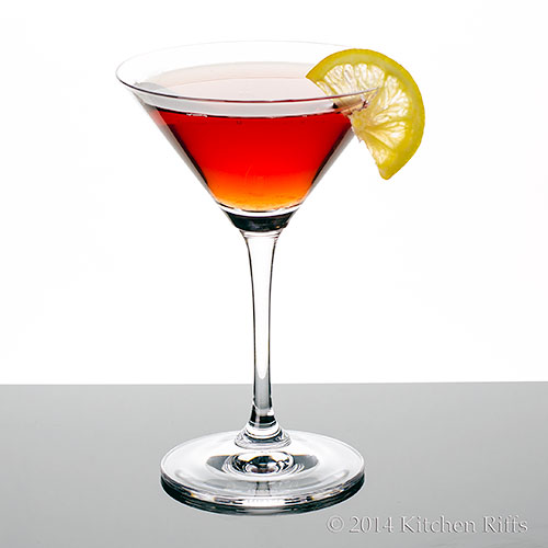 Dubonnet Cocktail in cocktail glass with lemon slice garnish
