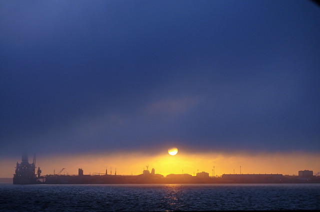foggy sunset over the port