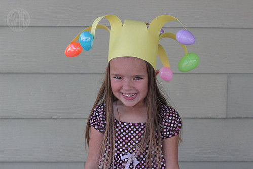 A child wearing floppy Easter egg jester hat