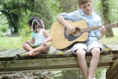 BLOG spencer and lily on bridge with guitar