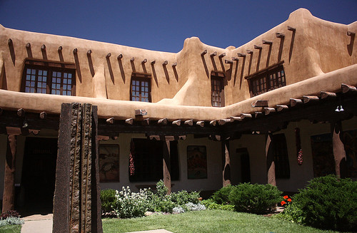 This pueblo style house is easy to categorize because of its flat roof, curves walls, and exposed timbers.