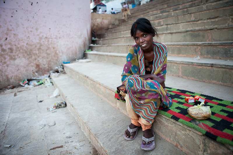 Woman on the steps of the main ghat in Varanasi