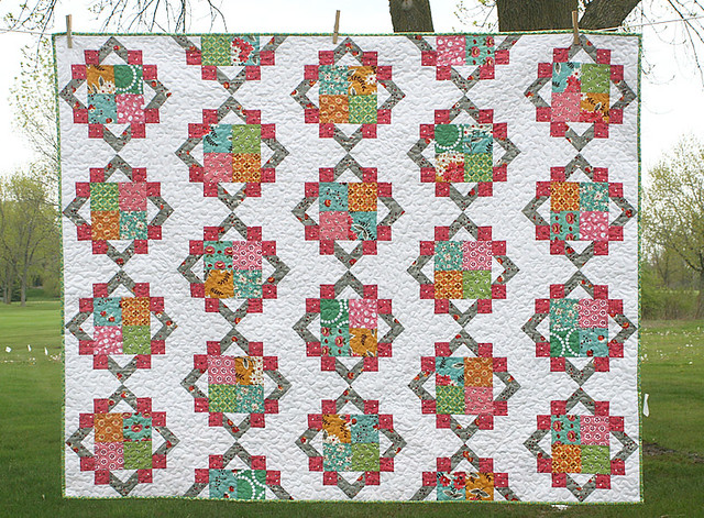 White Quilt with Colorful Diamond and Square Design
