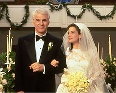 a screenshot from Father of the Bride, where Steve Martin is walking his daughter down the aisle