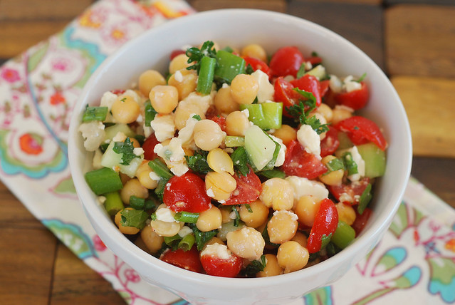 Mediterranean Vegetable Salad - chickpeas, tomatoes, cucumbers, and feta tossed with a light lemon garlic dressing with lots of fresh herbs!